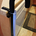 The Cane Butler cane holder attached to a dining room table